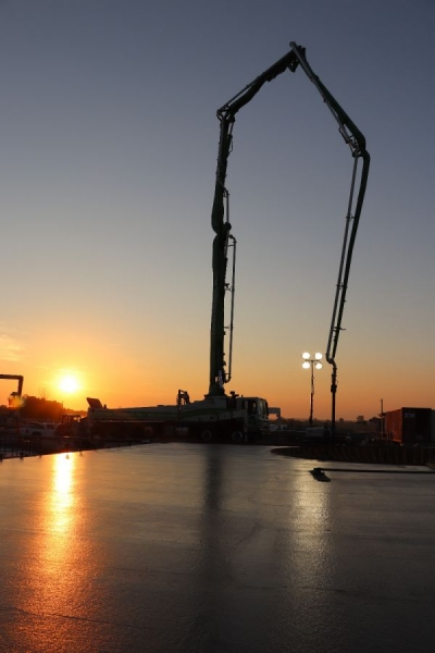 crane being shown with a beautiful sunset in the background
