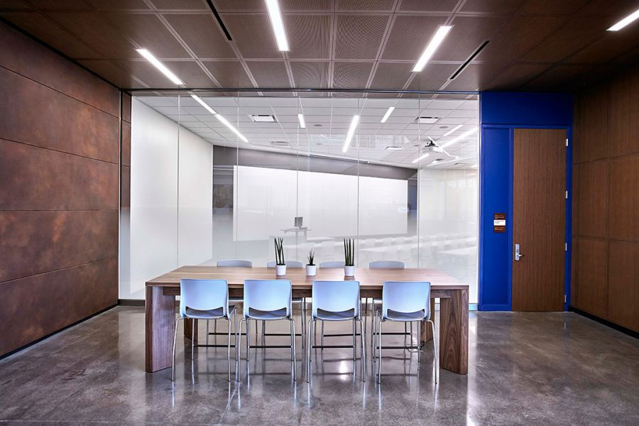 beautiful conference room featuring decorative concrete flooring