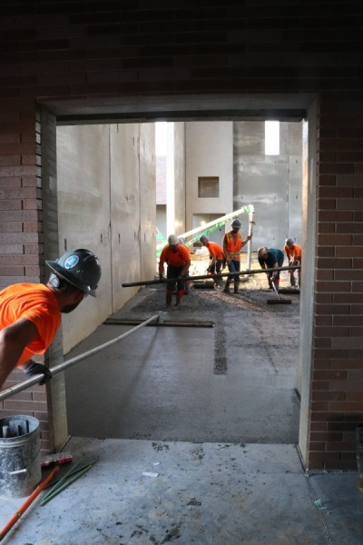 concrete contractors pouring structural concrete in park hill middle school