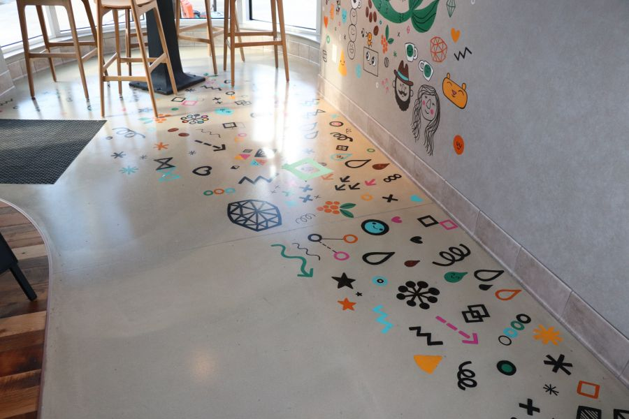 decorative concrete in starbucks with colorful images on the concrete