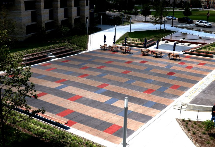 Lenexa civic center with decorative concrete outside of the building featuring red and blue