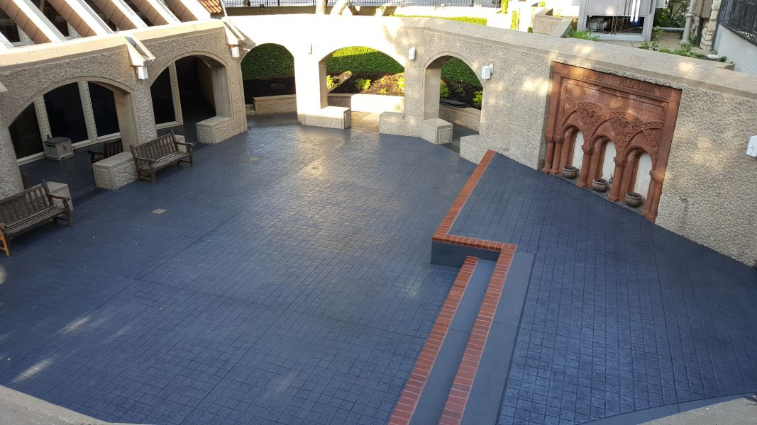 Grace & Holy Trinity Cathedral with beautiful blue decorative concrete with brick accents