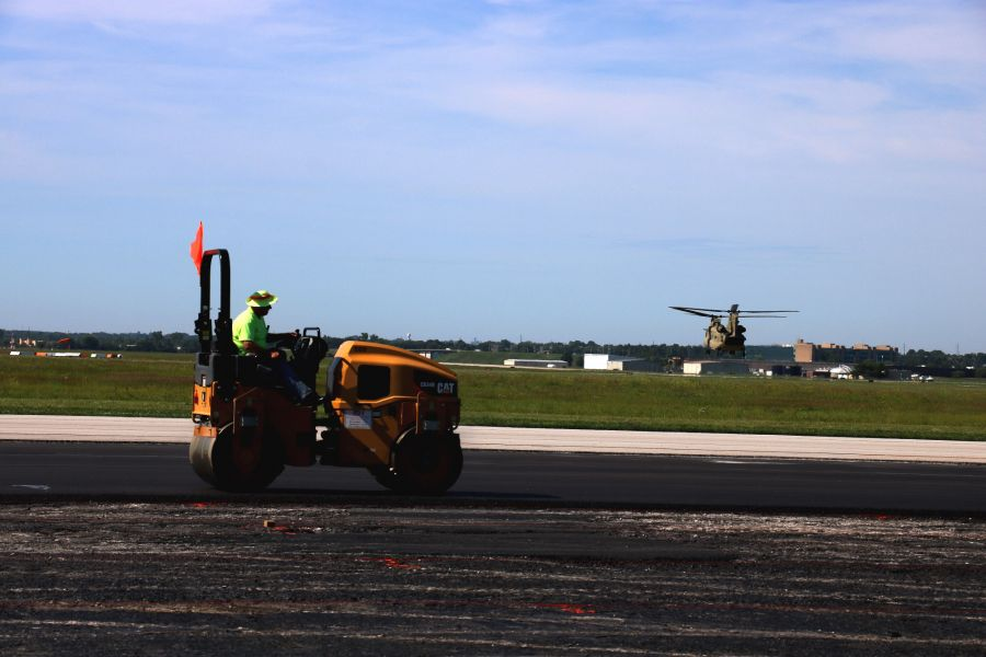 asphalt roller compacting the asphalt paving at the New Century Airport