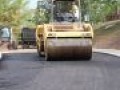 a asphalt roller smoothing out the asphalt paving