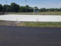 freshly paved asphalt and concrete at Wellsville High School