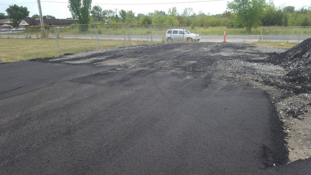 starting the process of paving asphalt near the main entrance for the track