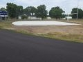 freshly laid asphalt pavement at Wellsville High School track