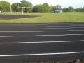 fresh asphalt paving with nice track lines for Wellsville High School Track