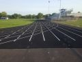 Wellsville High School Track with stadium seats to the right of the track