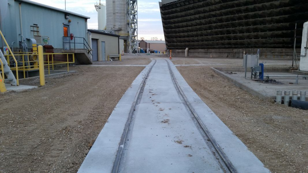 new concrete poured for railroad construction implementation