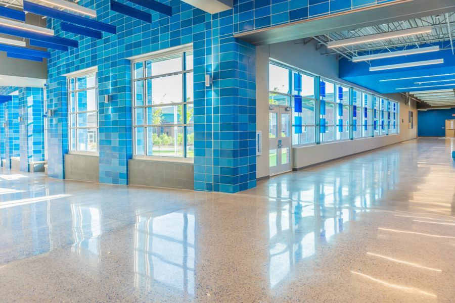 grain valley high school blue hallway concrete