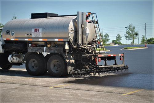 asphalt machine laying sealcoat