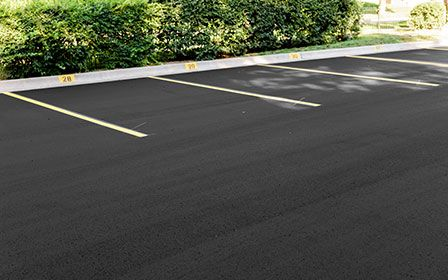 Fresh Asphalt Paving in Parking Lot