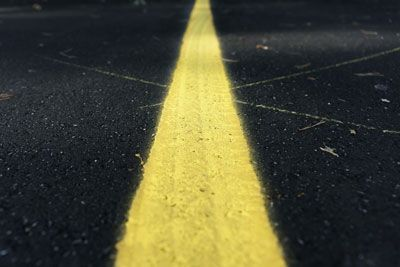 painted line on asphalt pavement